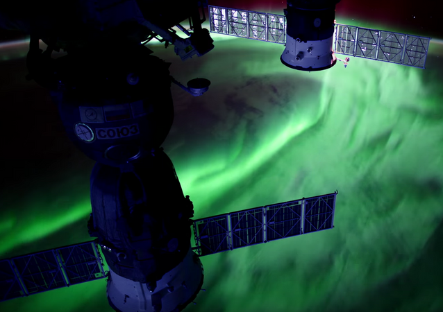 This still shows a stunning aurora captured from the International Space Station.