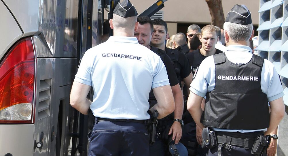 Repeating with additional information for clarification - Russian soccer fans (seen at center rear), suspected of being involved in clashes, are ushered off their bus after being stopped by gendarmes in Mandelieu near Cannes in southern France, June 14, 2016