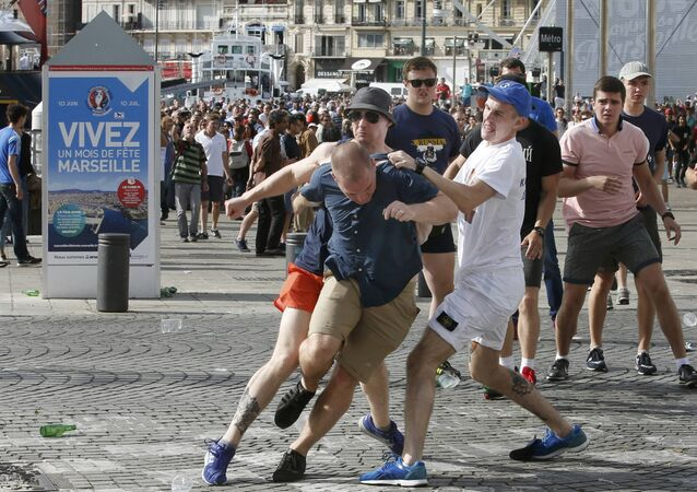 Football Soccer - Euro 2016 - England v Russia - Group B - Marseille, France - 11/6/16 Rival supporters clash at the old port of Marseille before the game.