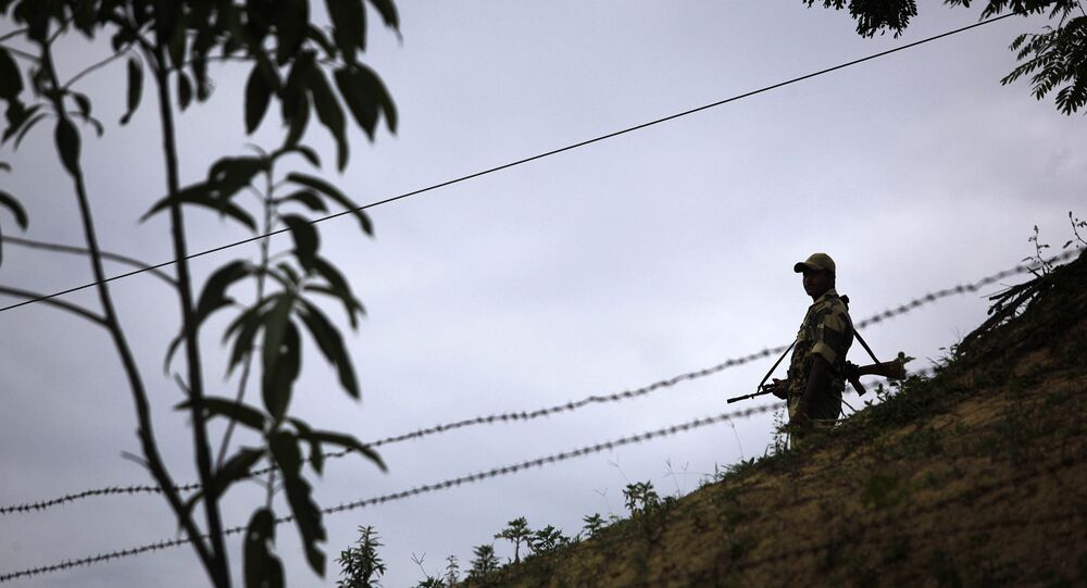 An Indian Border Security Force (BSF) soldier stands guard at the border outpost at Lathitilla near the India-Bangladesh border in Karimganj district of Assam, India. (File)