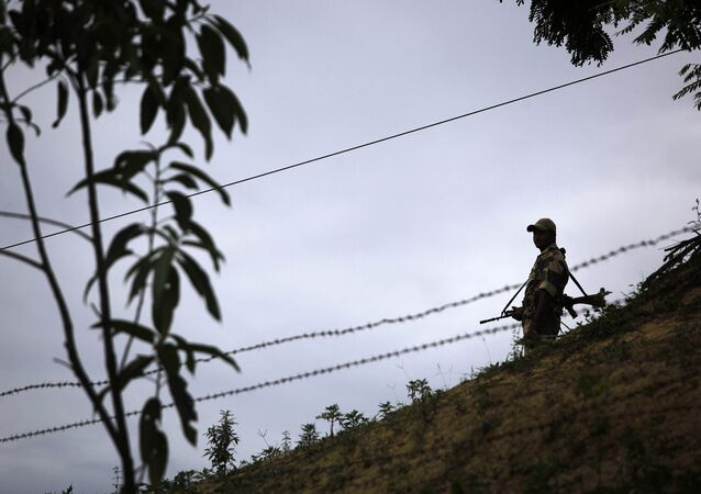 An Indian Border Security Force (BSF) soldier stands guard at the border outpost