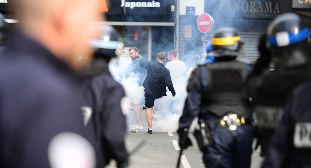 French policemen fire tear gas to disperse supporters gathering outside a bar in Lille, northern France