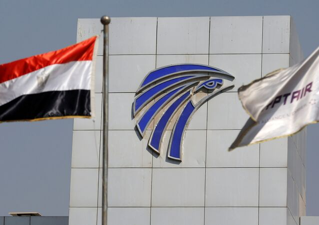 Egypt and EgyptAir flags are seen infront of an Egyptair in-flight service building at Cairo International Airport, Egypt.