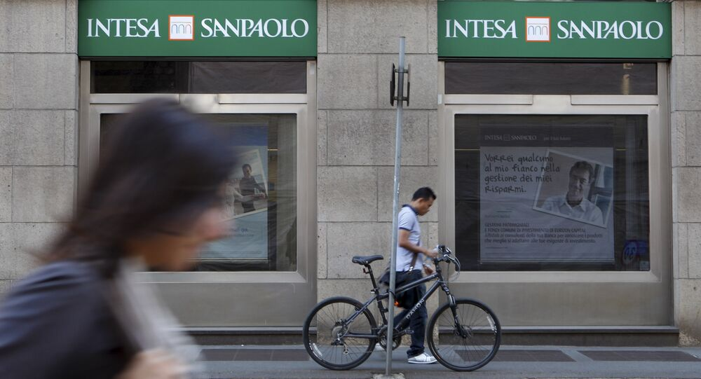 People walk past an Intesa Sanpaolo bank branch in Milan, Italy. (File)