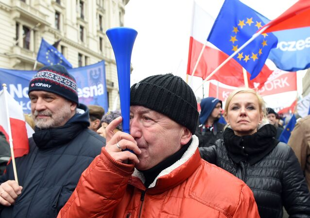 Thousands of people march in front of the presidential palace in Warsaw to protest against the government's moves that have paralyzed the nation's highest legislative court, the Constitutional Tribunal on March 12, 2016.