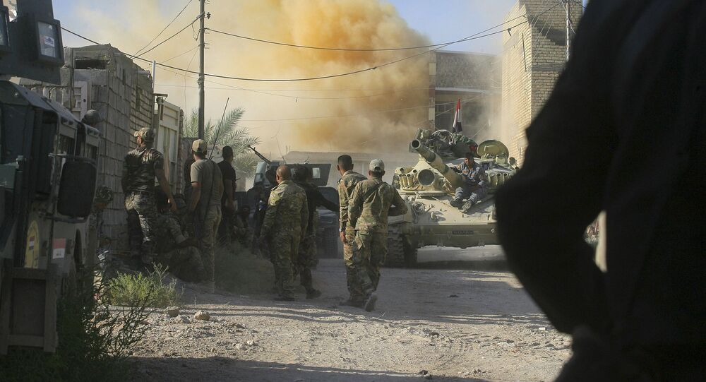 Smoke rises after an airstrike by a US-led coalition warplane as Iraqi security forces advance their position during heavy fighting against Islamic State militants in Fallujah, Iraq