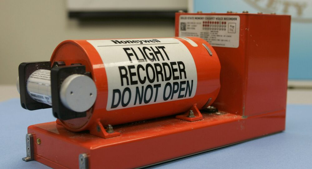 An example of a flight data recorder; the underwater locator beacon is the small cylinder on the far right.