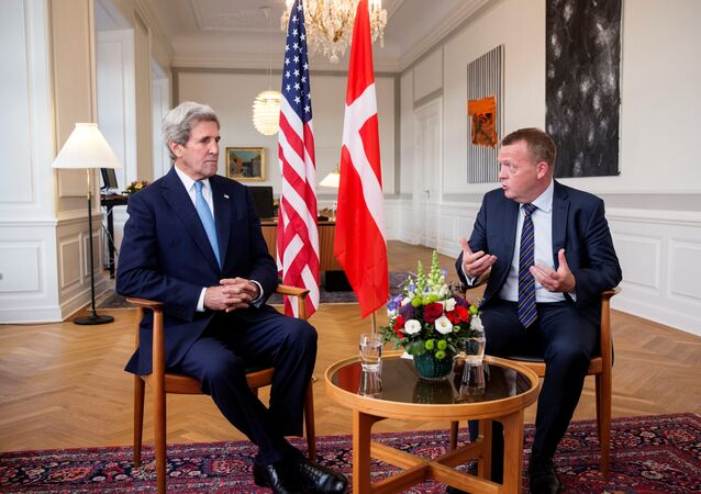 Danish Prime Minister Lars Lokke Rasmussen (R) and US Secretary of State John Kerry (L) sit for a meeting at Christiansborg Castle in Copenhagen, Denmark, 16 June 2016