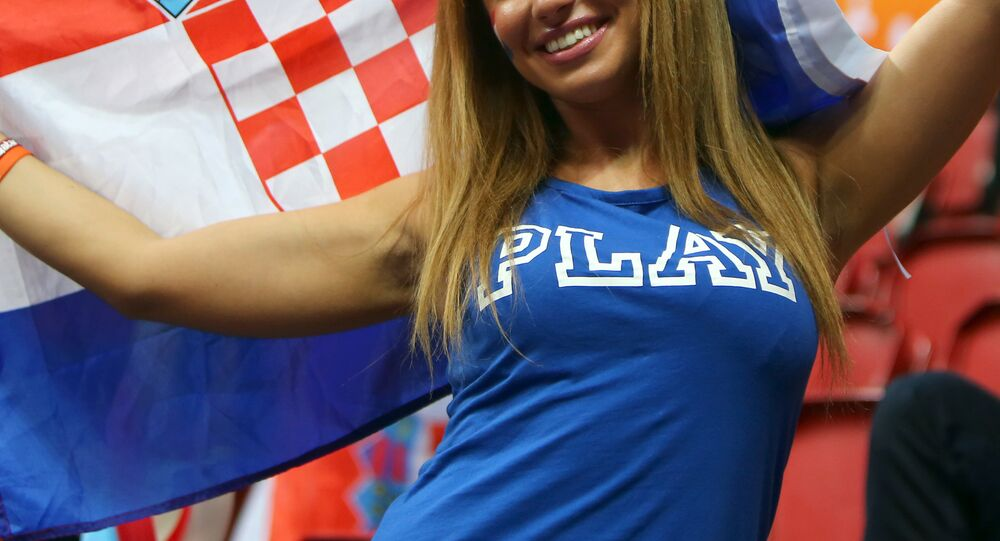 A Croatian fan holds up a flag during the 24th Men's Handball World Championships preliminary round Group B match between Macedonia and Croatia at the Duhail Handball Sports Hall in Doha on January 21, 2015