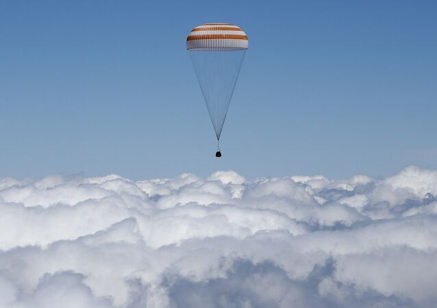 The Soyuz TMA-19M capsule carrying International Space Station (ISS) crew members, Tim Peake of Britain, Yuri Malenchenko of Russia and Tim Kopra of the U.S., descends beneath a parachute just before landing near the town of Zhezkazgan, Kazakhstan, on June 18, 2016