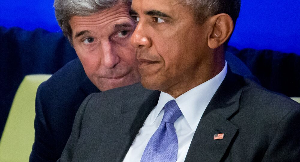 Secretary of State John Kerry speaks with President Barack Obama as he chairs the Leaders' Summit on Countering ISIL and Countering Violent Extremism, Tuesday, Sept. 29, 2015, at the United Nations headquarters