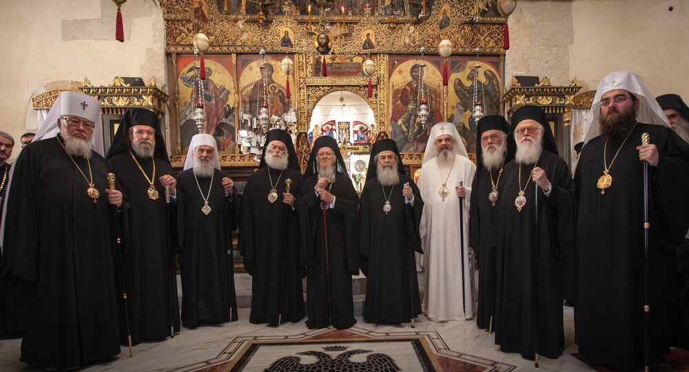 In this Friday, June 17, 2016 photo released by Holy and Great Council, leaders of ten Orthodox churches pose for a family picture at the Orthodox Academy of the Greek island of Crete