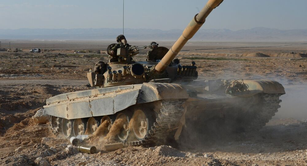 A T-72 tank of the Fatimiyoun Brigade at the frontline in the mountains 10 km from Palmyra