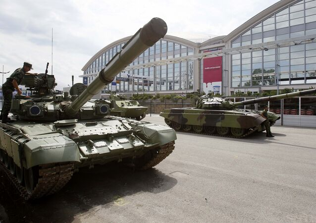 A Serbian army soldier inspects an M-84 battle tank during a defense fair, in Belgrade, Serbia, Tuesday, June 28, 2011