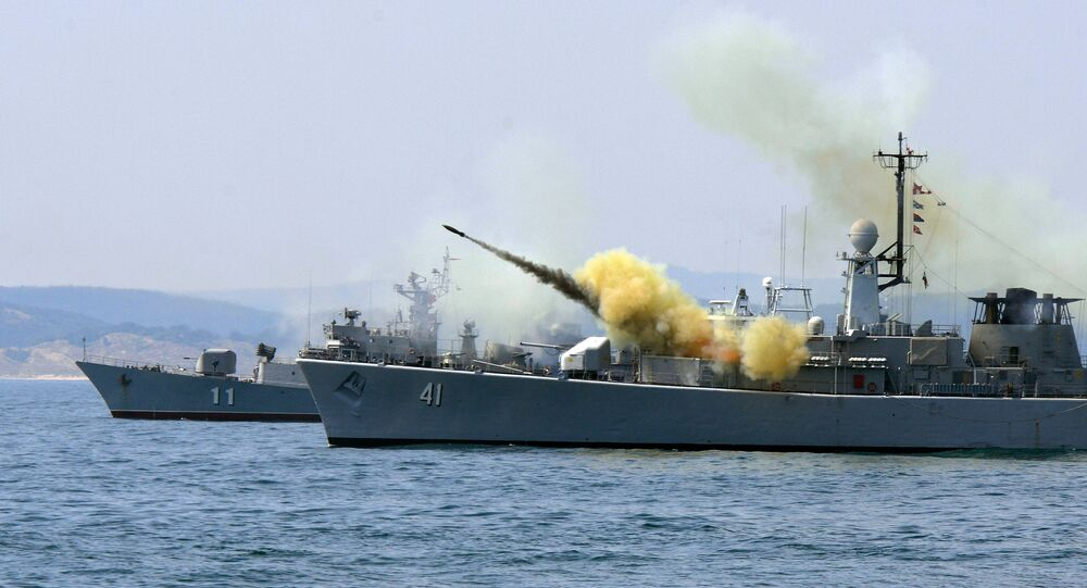 An anti-submarine rocket blasts off a rocket launcher from the Bulgarian navy frigate Drazki during the BREEZE 2014 military drill in the Black Sea on July 11, 2014
