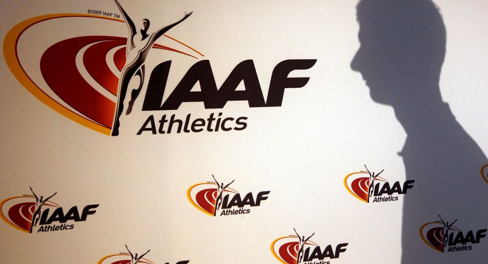 A man casts his shadow following a press conference by Sebastian Coe, IAAF's President, as part of the 203nd International Association of Athletics Federations (IAAF) council meeting in Monaco, March 11, 2016