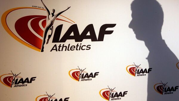 A man casts his shadow following a press conference by Sebastian Coe, IAAF's President, as part of the 203nd International Association of Athletics Federations (IAAF) council meeting in Monaco, March 11, 2016 - Sputnik International