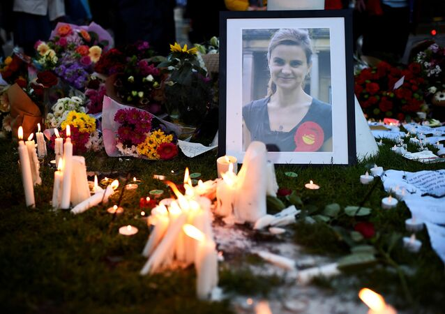 Mourners leave candles in memory of murdered Labour Party MP Jo Cox, who was shot dead in Birstall, during a vigil at Parliament Square in London, Britain June 17, 2016