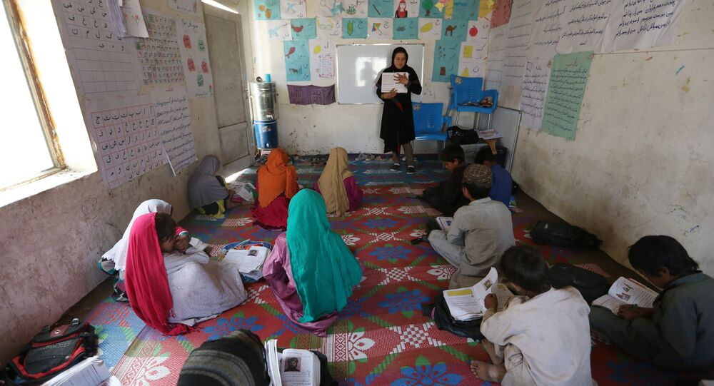 Afghan internally displaced school girls study at the class near their temporary home in Kabul, Afghanistan, Tuesday, May 31, 2016