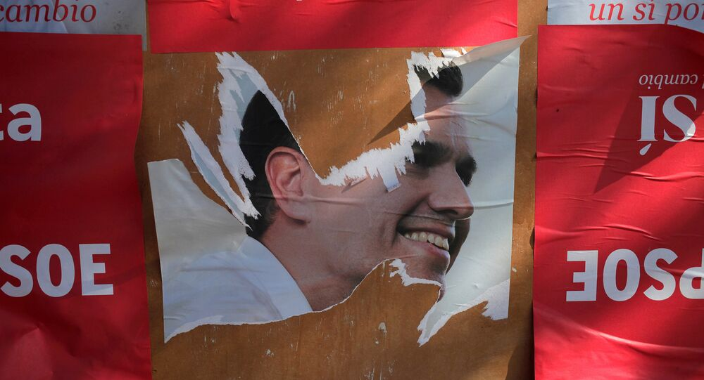 A ripped poster of Spain's Socialist Party (PSOE) leader Pedro Sanchez is seen on a wall in Benalmadena, southern Spain, June 15, 2016.