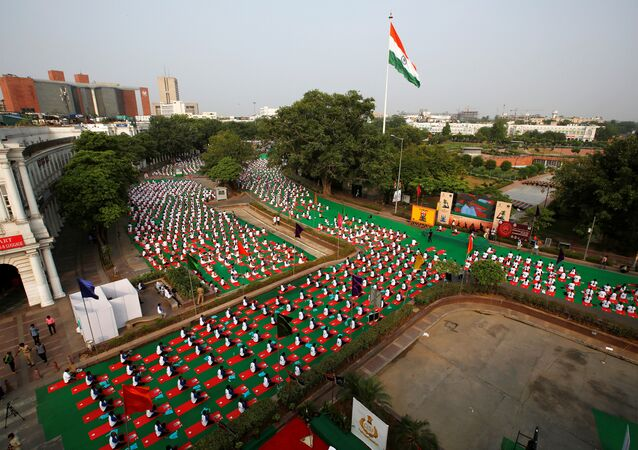 Participants perform yoga during World Yoga Day in New Delhi, India