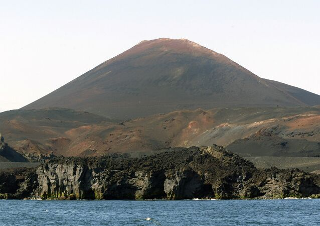 A photo showing the Hekla volcano on the Heimaey island, belonging to the Vestmann archipelago