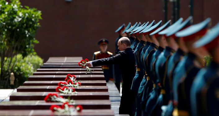 Russian President Vladimir Putin attends a wreath-laying ceremony marking the 75th anniversary of the Nazi German invasion, by the Kremlin walls in Moscow, Russia, June 22, 2016