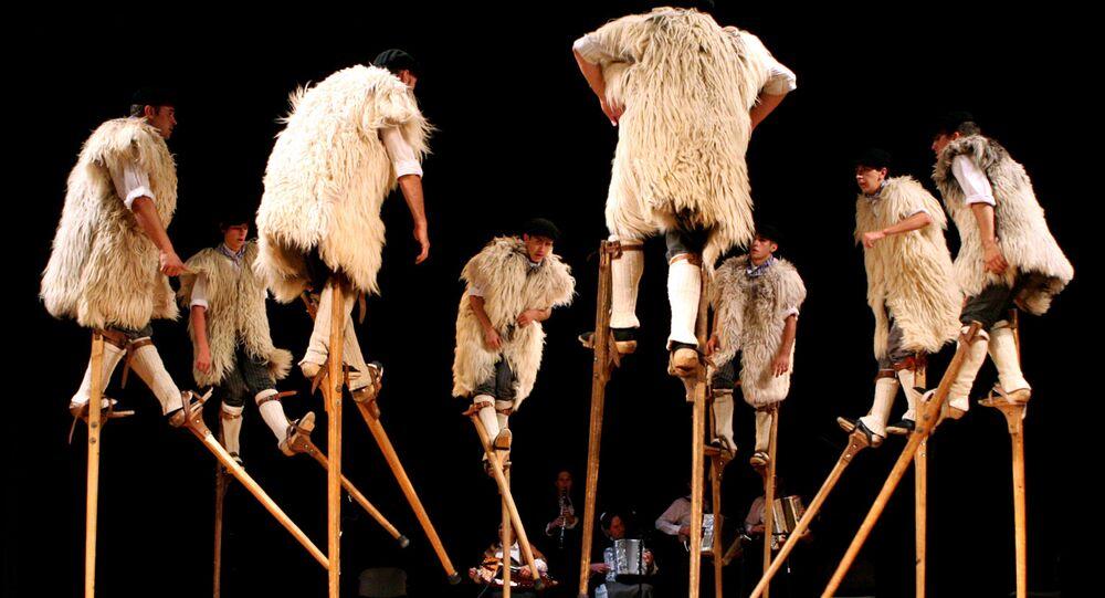 French stilt dancers. Doing the 'Hokey Pokey'?