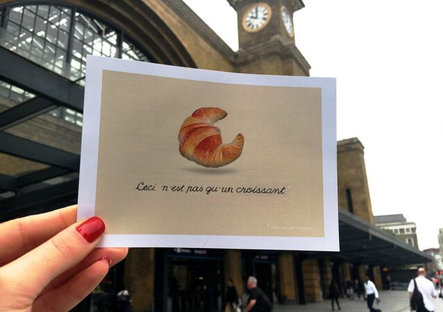 'Operation Croissant' Parisians Hand Out Postcards from Paris Ahead of UK Referendum