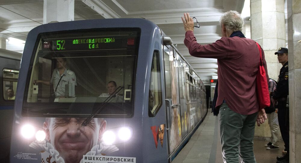 British actor Ian McKellen, right, greets the themed train Shakespeare Passions on the Moscow Metro. The train has been launched on Filyovskaya Line under the project Shakespeare Lives which is dedicated to the 400th anniversary of William Shakespeare's death and marks the UK-Russia Year of Language and Literature 2016.