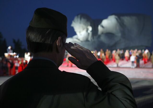 A veteran of Soviet Army salutes during a ceremony to mark the Day of Remembrance and Sorrow, on the 75th anniversary of Germany's attack on the Soviet Union in World War II in the Brest Fortress memorial, 360 kilometers (225 miles) southwest of Minsk, Belarus