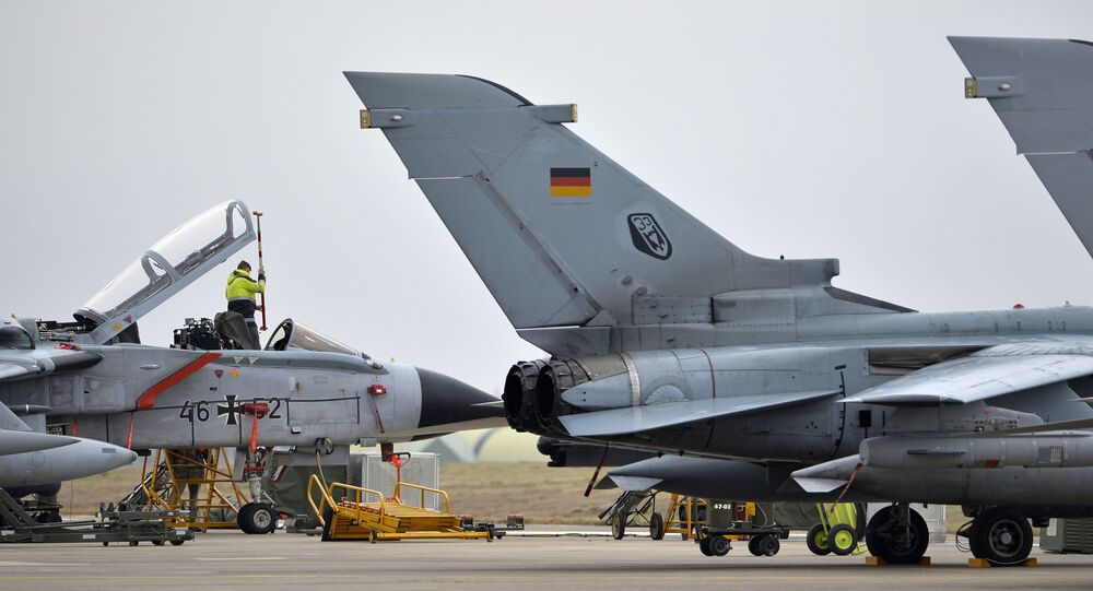 A technician works on a German Tornado jet at the NATO air base in Incirlik, Turkey.