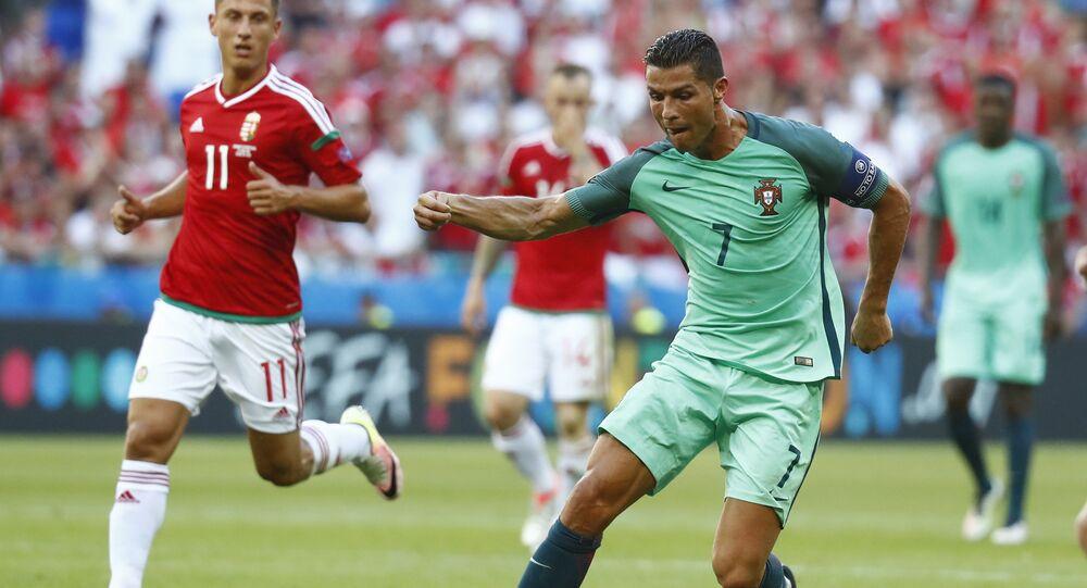 Football Soccer - Hungary v Portugal - EURO 2016 - Group F - Stade de Lyon, Lyon, France - 22/6/16 Portugal's Cristiano Ronaldo in action with Hungary's Krisztian Nemeth