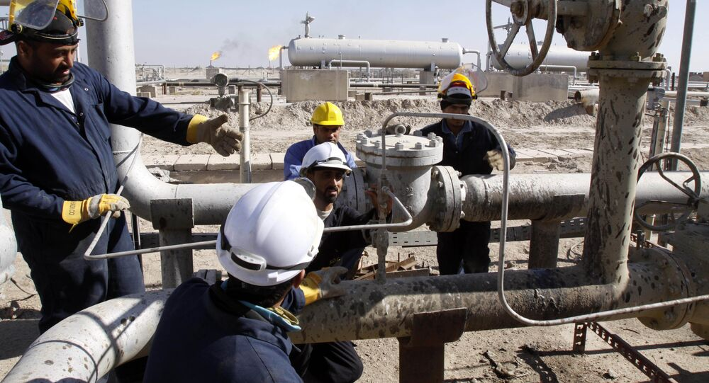 Oil workers are seen at the West Qurna Phase 2 field in the Basra region, 550 kilometers (340 miles) southeast of Baghdad, Iraq
