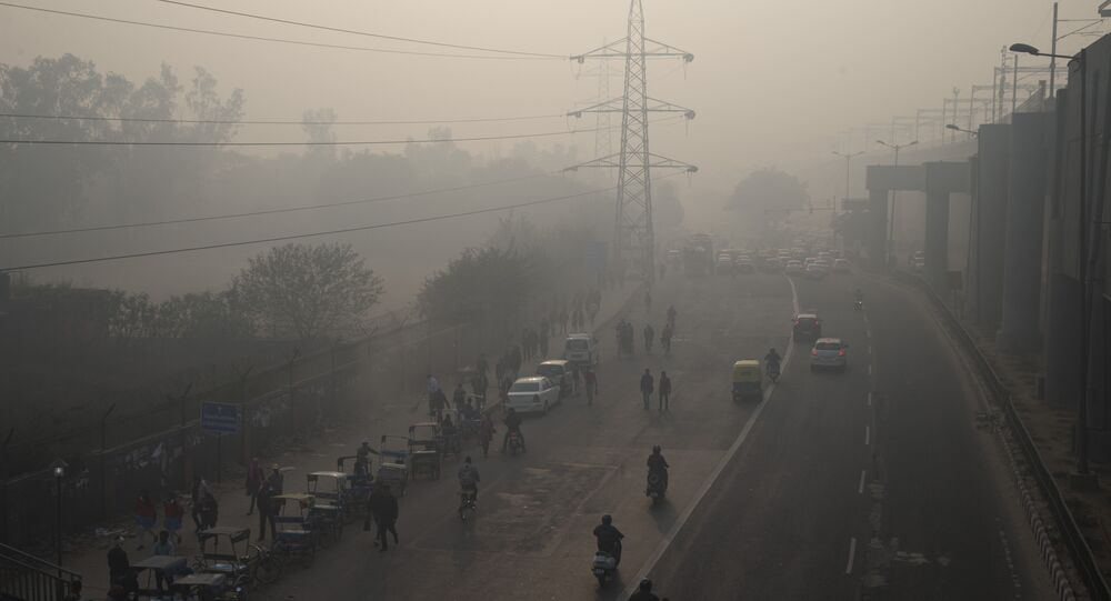 Vehicles ply through the morning smog in New Delhi, India.