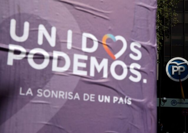 Posters of the coalition of Unidos Podemos (United We Can) hang near the People's Party (PP) headquarters in Madrid, Spain