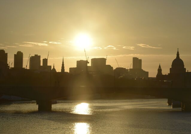 Dawn breaks over the City of London, Britain