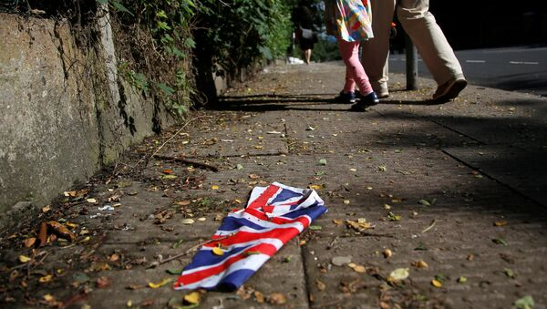 A British flag which was washed away by heavy rains the day before lies on the street in London, Britain, June 24, 2016 after Britain voted to leave the European Union in the EU BREXIT referendum. - Sputnik International