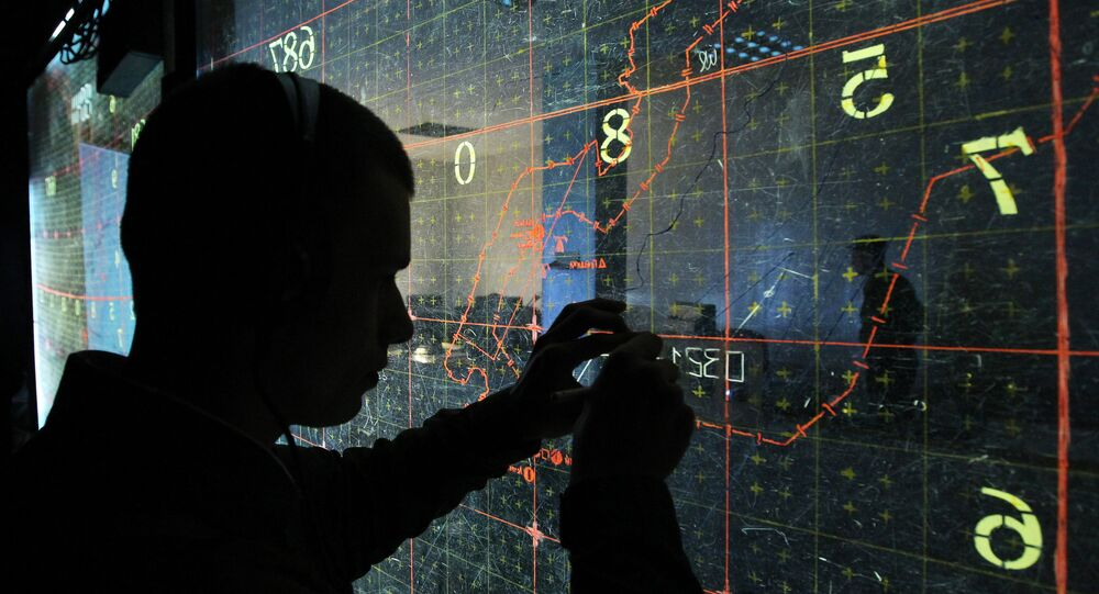An operator by the map-board at the training command center during large-scale exercises of the Air Force and Air Defense troops
