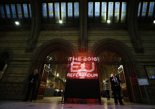 Security guards stand guard at the doors of the announcement hall in Manchester Town Hall , northwest England on June 23, 2016