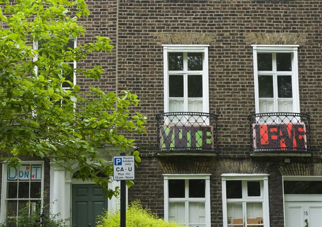 Vote Leave signs placed on the balconies in Highgate Road, North London, as residents vote in a referendum on whether to remain part of European Union or leave.