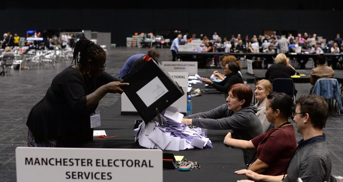 Election workers in the United Kingdom counting ballots following the country's vote on EU membership, June 24, 2015