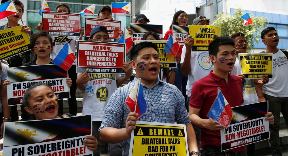 Members of Akbayan party list group chant slogans during a protest regarding the disputed islands in the South China Sea, in front of the Chinese Consulate in Makati City, Metro Manila, Philippines June 10, 2016
