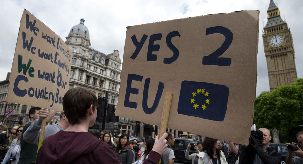 A demonstrator holds a placard during a protest against the outcome of the UK's June 23 referendum on the European Union (EU), in central London on June 25, 2016