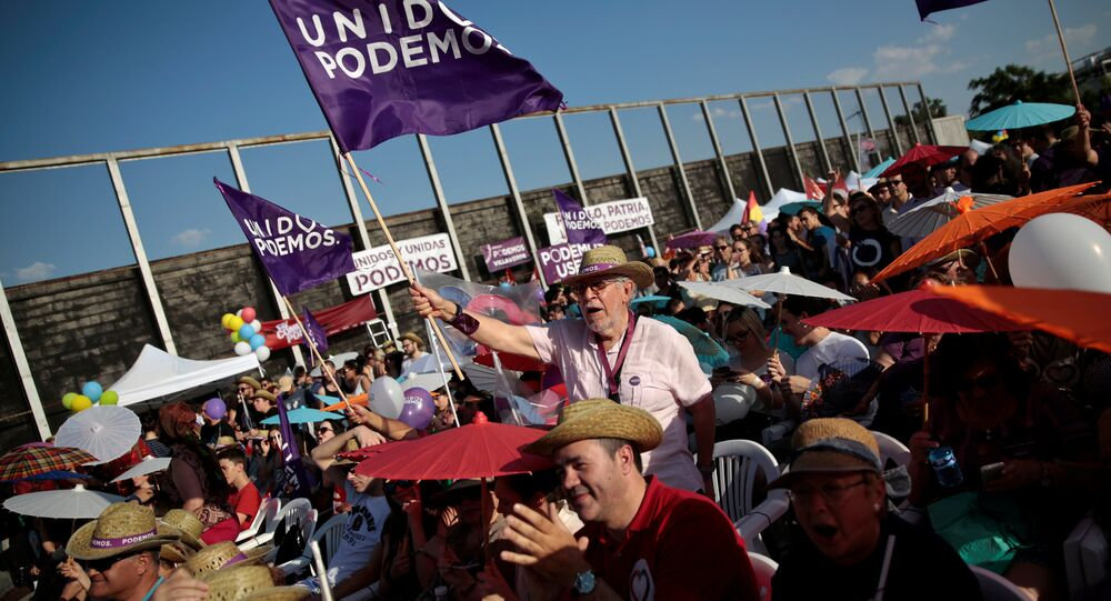 Supporters of the coalition Unidos Podemos (Together We Can) attend the last campaign rally for Spain's upcoming general election in Madrid, Spain, June 24, 2016