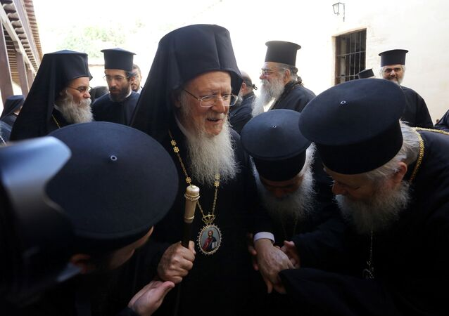 Orthodox priests pay their respects to Ecumenical Patriarch Bartholomew I, before the summit of the Holy and Great Council, the gathering of spiritual leaders of the world's Orthodox Christians, in the Gonia Monastery, near the town of Chania, on island of Crete, Greece, June 20, 2016