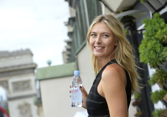 Russina tennis player and international ambassador for French mineral water company Evian, Maria Sharapova poses during a photocall prior to the start of the sporting season for the Evian brand (Tennis and Golf) in Paris on May 18, 2015