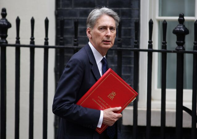 British Foreign Secretary Philip Hammond arrives in 10 Downing Street in central London on May 13, 2016