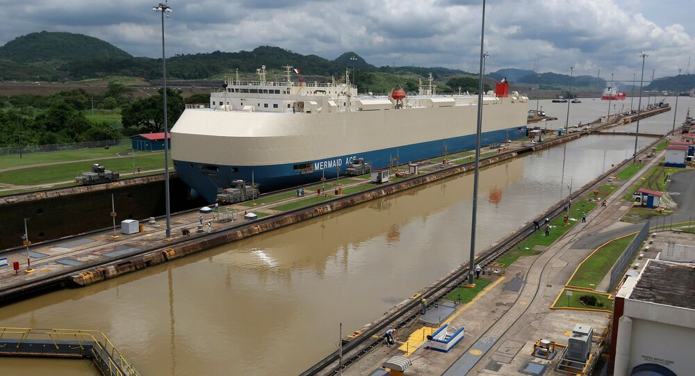 A cargo ship is pictured crossing through the Miraflores locks, a day before the inauguration of the Panama Canal Expansion project, in Panama City, Panama June 25, 2016