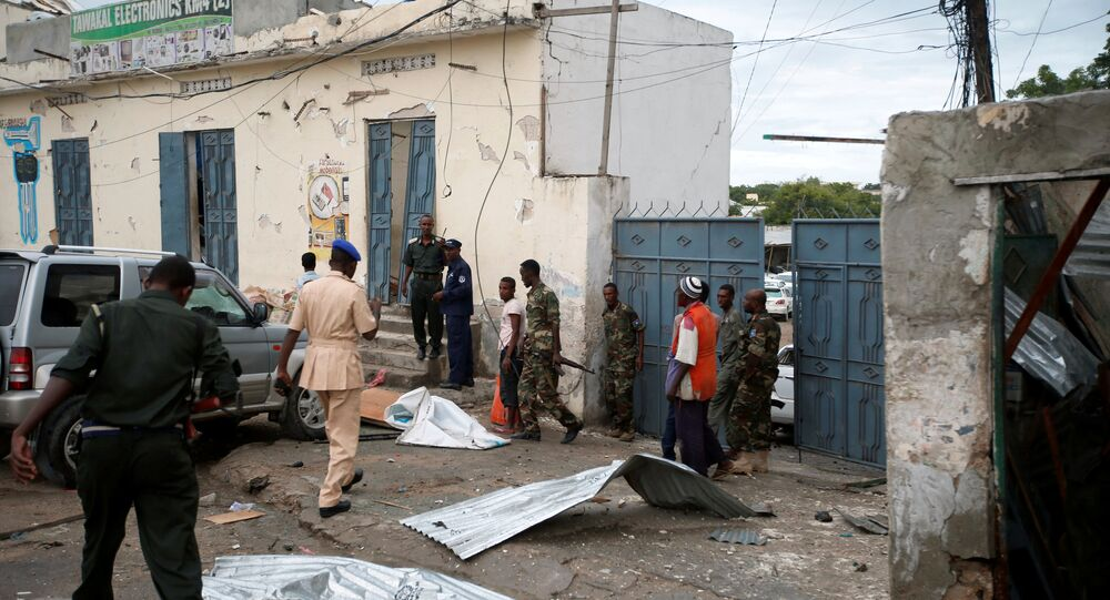 Somali government soldiers and police gather near the scene of gunfire after a suicide bomb attack outside Nasahablood hotel in Somalia's capital Mogadishu, June 25, 2016